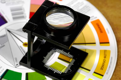 Photograph of printers loupe and colour charts.